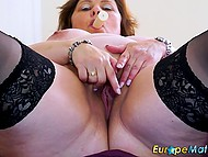 Mature BBW in black stockings leisurely masturbates vagina with sex toy alone 11