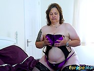Mature BBW in black stockings leisurely masturbates vagina with sex toy alone 6
