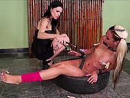 Brunette mistress lights a lot of candles to pour girl's body with tons of hot wax 10