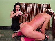 Brunette mistress lights a lot of candles to pour girl's body with tons of hot wax 5
