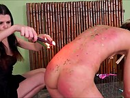 Brunette mistress lights a lot of candles to pour girl's body with tons of hot wax 6