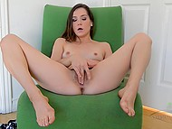 Teenage sweetie sat down in green armchair and gladly played with hairy pussy 4