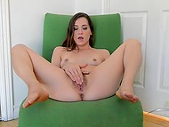 Teenage sweetie sat down in green armchair and gladly played with hairy pussy 6