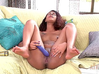 Curly-haired Ebony gal instead of traditional fingering prefers to touch her peach with vibrator