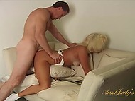 Mature blonde fucked well on couch before muscular partner ejaculates all over her face 8