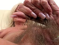 Winning mature lays on couch and gently widens her hairy pussy with fingers 4