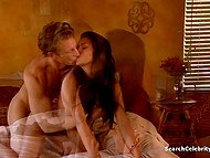 Comely brunette and her handsome lover passionately make love in several poses 9