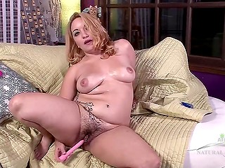 Blonde chick oiled hairy vagina and breasts then actively played with dildo on couch