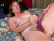 Lonely mature compensates lack of partner by masturbating her hairy pussy with vibrator 9