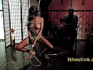 Master sits and watches how tied Ebony chick touches her snatch with vibrator