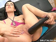 Feisty brunette penetrates her tight pussy with the help of massive black rambone