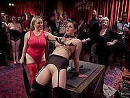 At special play party, busty dominatrix pinches tits of submissive girl and spanks her a lot