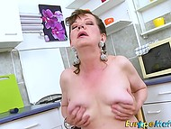 Excited mature masturbates her hairy cunny with fingers and toy right in kitchen 9