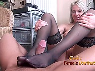 Horny MILF in black stockings gives professional handjob to dude who relaxes on floor 4