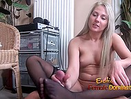 Horny MILF in black stockings gives professional handjob to dude who relaxes on floor 9