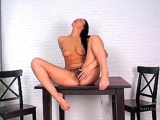 Lustful brunette played with her hairy pussy and started to suck adult toy alone