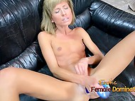 Petite chick with small boobies laid down on black sofa and masturbated vagina with dildo 10