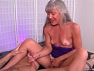Mature woman with gray hair knows better than young girls how to give handjob 7
