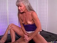 Mature woman with gray hair knows better than young girls how to give handjob 8