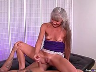 Mature woman with gray hair knows better than young girls how to give handjob 9