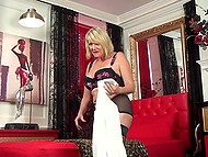 Experienced blonde in sexy stockings takes off lingerie and soon starts fingering her twat 5