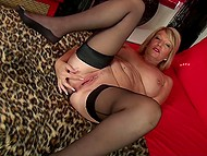Experienced blonde in sexy stockings takes off lingerie and soon starts fingering her twat