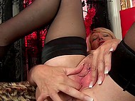 Experienced blonde in sexy stockings takes off lingerie and soon starts fingering her twat 9