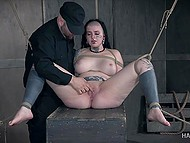 Harsh man ties plump girl with horns and makes her peach dripping with help of a vibrator