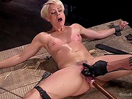 Man controls mechnick dildo and moves it in slender MILF's pussy and she is delighted with this