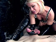 Blonde-haired mistress in gloves holds tattooed slave's weapon hard and squeezes jizz out 8