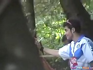 Hiding behind a tree, cameraman manages to record sexual act of teen couple in backwoods 11