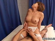 Stacked female from Japan pulls lace panties aside to ride cock with hairy pussy