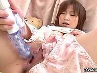Sex toy fills tender pussy of cute Japanese girl to the full and brings her sacred orgasm
