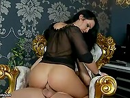 Hungarian brunette chooses armchair with golden inlay as place for anal fucking