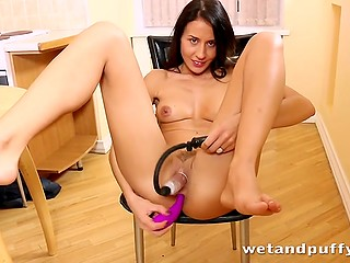 Dark-haired Lithuanian girl pisses several times caressing her clitoris with vibrator