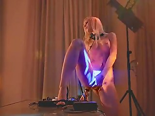 Blonde Swedish DJ turns on extremely cool beat and gets excited right in front of turntables