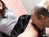 Old pervert goes mad about tickling young Japanese babe's clitoris in XXX video 10
