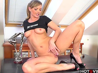 Smiling coquette in high heels knows how to use vibrators to relax quickly on table