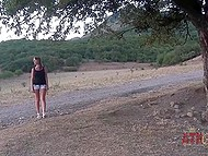 Suntanned girl with pretty face walked down the hill then leisurely undressed by tree 4