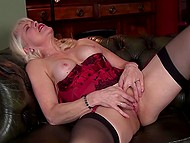 Amazing granny in stockings tries to stimulate her sweet clit for divine pleasures