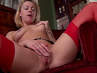 Blonde MILF demonstrates her sexy lingerie and pushes in pussy her favorite finger