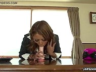 Sexy headmistress from Japan is tired of sitting in office and cheers herself up with favorite adult toys 6