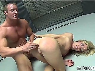 Hot blonde gets the prize when seduces attractive guy in a cool fighting cell