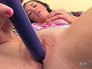 Chesty lassie with tanned body spread her legs widely and put vibrator on shaved pussy 4