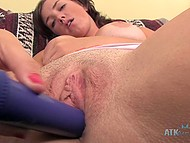 Chesty lassie with tanned body spread her legs widely and put vibrator on shaved pussy 5