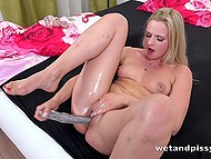 Blonde babe Katy Sky peed then grabbed big dildo and helped herself to squirt