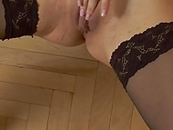 Long-haired diva in sexy lingerie demonstrates elegant body and plays with her peach 10