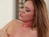 Sexy masseuse gives massage to busty babe and carefully rubs her charming pussy 7