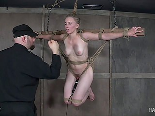 Experienced pervert tied up pretty girl to ceiling and excited her pussy in basement