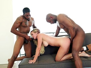 Hypnotizing MILF with golden hair can easily deal with two great black penises